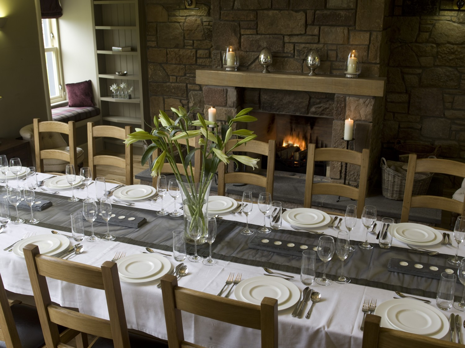 All 16 guests in the double heighted dining hall
